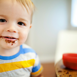 child eating cake